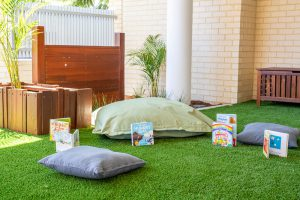 kids playing area with green grass carpet in nido child care centre at belmont