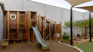 children outside playing area image of nido child care centre at lakelands