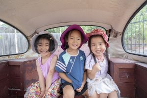 3 kids sitting in the car image of nIdo child care centre in templestowe