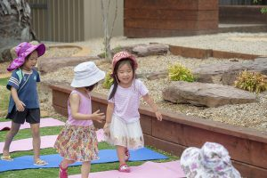 kids playing in the playground of nIdo child care centre in templestowe